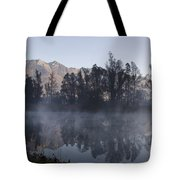 Mountain And Trees Reflected In A Foggy Lake Tote Bag