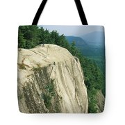 Mountain Biker On Edge Of Cliff Tote Bag