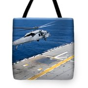 N Mh-60s Sea Hawk Helicopter Lifts Tote Bag