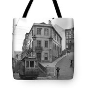 Narrow Streets And Streetcar In Lisbon Tote Bag