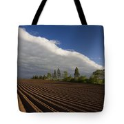 Newly Planted Potato Field And Clouds Tote Bag