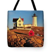 Nubble Light Sunset Tote Bag by Catherine Reusch Daley