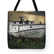 Old Fishing Boat On Shore With Storm Moving In Tote Bag