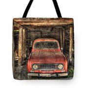 Old Red Car In A Wood Garage Tote Bag