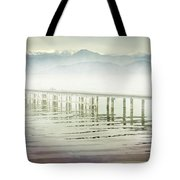 Old Wooden Bridge Into A Mountain Lake On A Foggy Morning Tote Bag