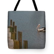 Pelican In The Water Next To A Timber Landing Pier Tote Bag