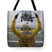 Petty Officer Guides An Sh-60r Sea Hawk Tote Bag