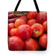 Pile Of Red Luscious Tomatoes Along With Carrots On A Vegetable Basket Tote Bag