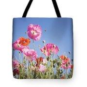 Pink Flowers Against Blue Sky Tote Bag