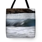 playing with waves 1 - A beautiful image of a wave rolling in noth coast of Menorca Tote Bag