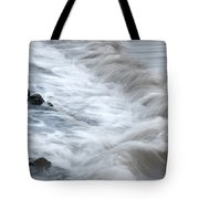 playing with waves 3 - Mediterranean sea foam playing with black stones in cala mesquida - menorca Tote Bag