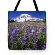 Purple Flowers Blooming Beneath Mount Tote Bag