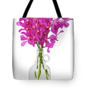 Purple Orchid In Bottle Tote Bag by Atiketta Sangasaeng