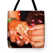 Putting The Gold And Diamond Engagement Ring On The Finger Of The Lady Tote Bag