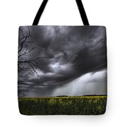 Rain And Thunderstorm Over A Canola Tote Bag