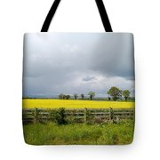 Rain Clouds Over Canola Field Tote Bag