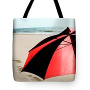 Red And Black Umbrella On The Beach With Footprints Tote Bag