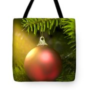 Red Ball In A Real Caucasian Fir Christmas Tree Tote Bag