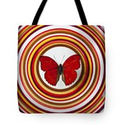 Red Butterfly On Plate With Many Circles Tote Bag by Garry Gay