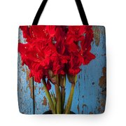 Red Glads Against Blue Wall Tote Bag