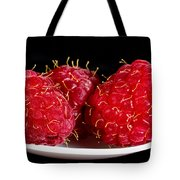 Red Raspberries On A White Spoon Against Black No.0102 Tote Bag