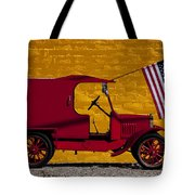 Red Truck Against Yellow Wall Tote Bag