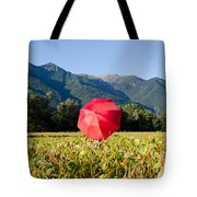 Red Umbrella On The Field Tote Bag