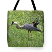 Red-winged Blackbird Attacking Great Blue Heron Tote Bag