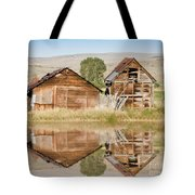 Reflection Of An Old Building Tote Bag by Donna Greene