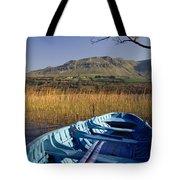 Row Boat Amongst Reeds On A Lake Tote Bag