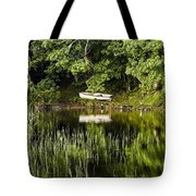 Rowboat Moored On The Bank Of A Lake Tote Bag