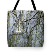Sailing Boat Behind Tree Branches Tote Bag