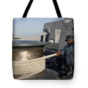 Sailors Handle Mooring Lines Aboard Uss Tote Bag