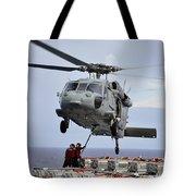 Sailors Hook An Ammunition Pallet To An Tote Bag