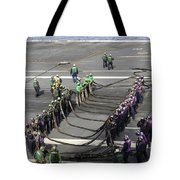 Sailors Participate In A Barricade Tote Bag