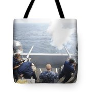 Sailors Perform A 21-gun Salute Aboard Tote Bag by Stocktrek Images