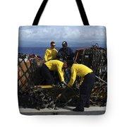 Sailors Prepare Pallets Of Cargo Aboard Tote Bag