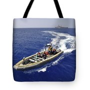 Sailors Transit An Inflatable Boat Tote Bag