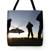 Sailors Watch A Helicopter Lift Tote Bag