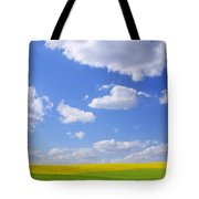 Scenic View Of Meadow And Canola Crop Tote Bag