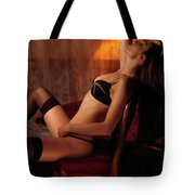 Sexy Young Woman Sitting In A Chair Tote Bag