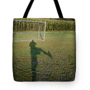 Shadow From A Football Player Tote Bag