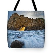 Shaft Of Sunlight Through Hole In Rock Tote Bag by Robert Postma