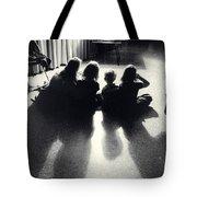 Siblings Watch Television Tote Bag