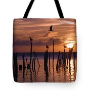 Silhouette Of Seagulls On Posts In Sea Tote Bag