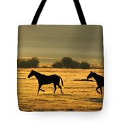 Silhouetted Horses Running Tote Bag