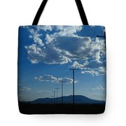 Silhouetted Telephone Poles Under Puffy Tote Bag