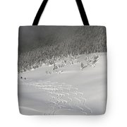 Skiers At The Base Of A Mountain Tote Bag
