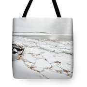 Small Boat Sits On Ice Chuncks In Wellfleet On Cape Cod In Winte Tote Bag