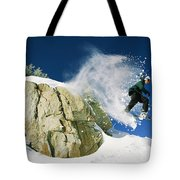 Snowboarder Jumping Off A Big Rock Tote Bag